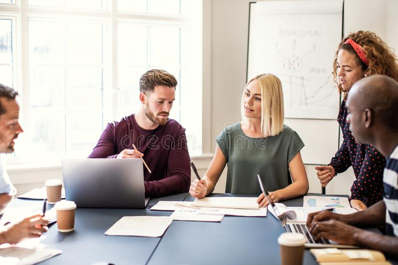 Focused group of designers working together in an office stock photo