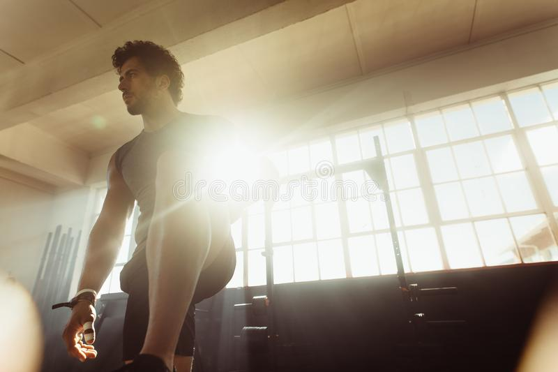 Focused male athlete at cross training gym royalty free stock photo