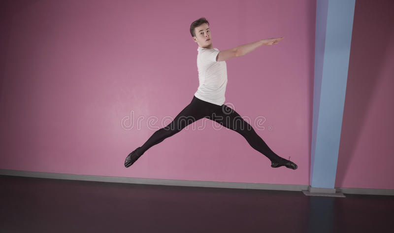Focused male ballet dancer leaping royalty free stock photography