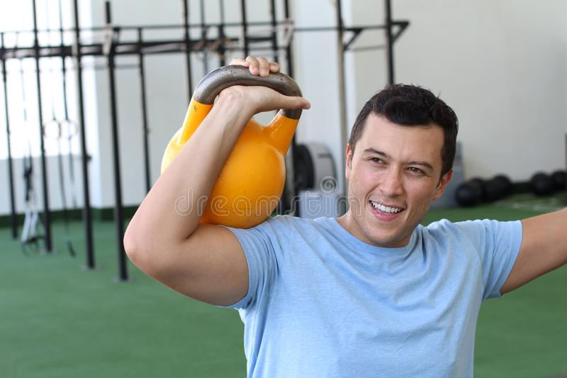 Focused male during functional workout stock images