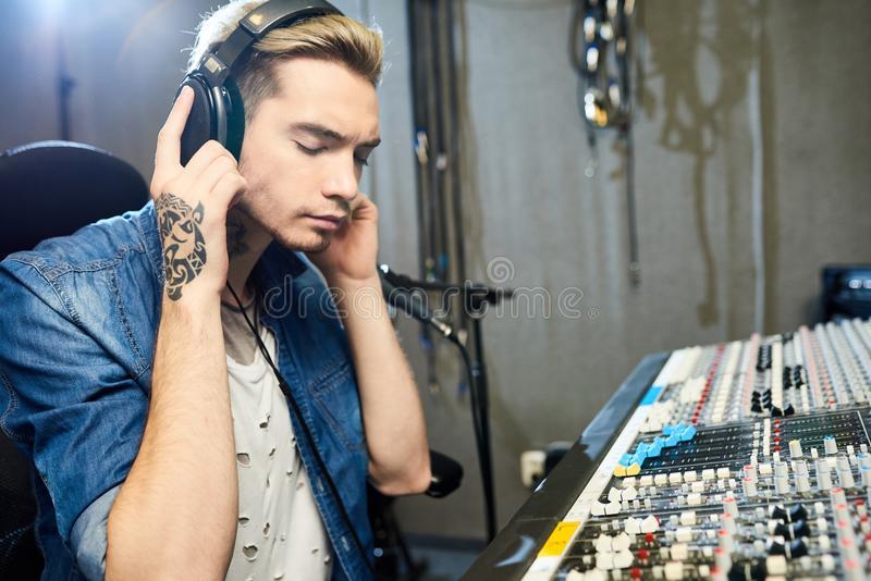 Focused man listening to music recording royalty free stock photography