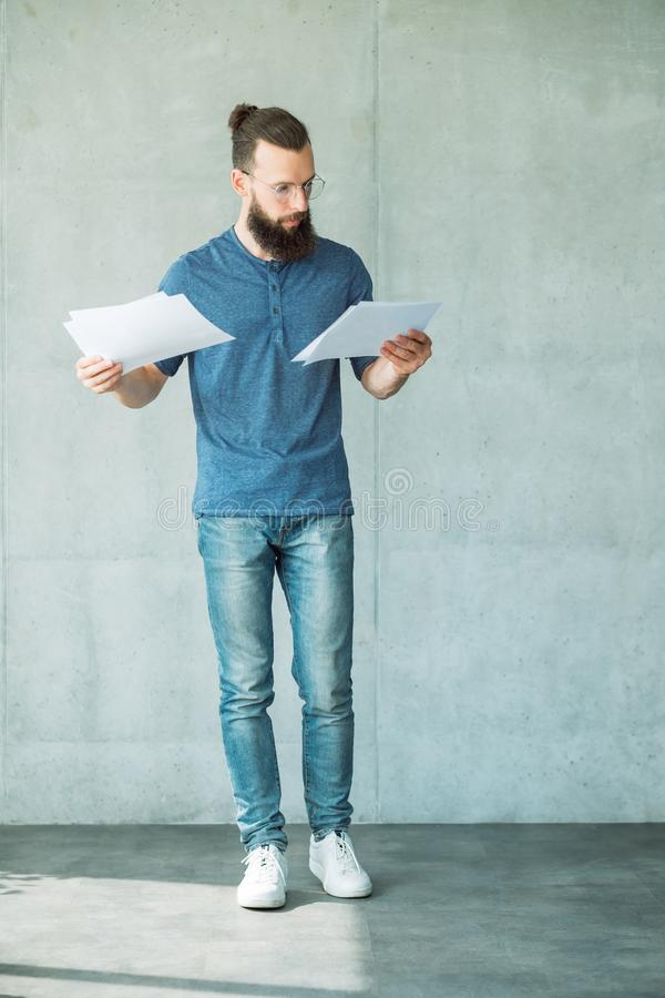 Focused man read business documents information royalty free stock image