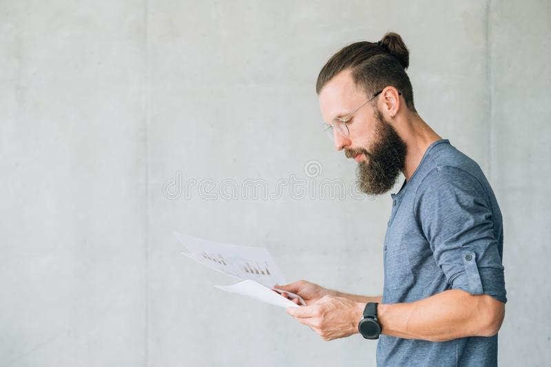 Focused man read document information report data royalty free stock photos