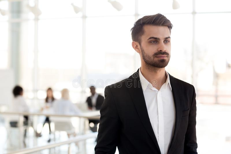 Focused millennial businessman look in distance dreaming of busi royalty free stock photography