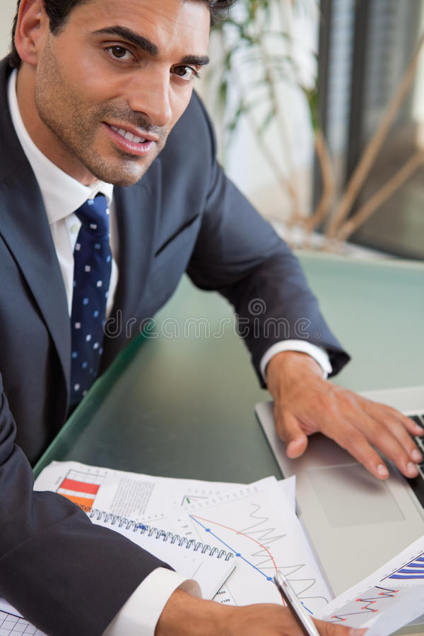 A focused sales person studying statistics