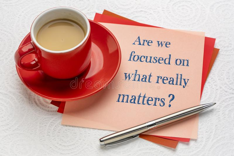 Are we focused on what really matters. ? A note with a cup of coffee royalty free stock image