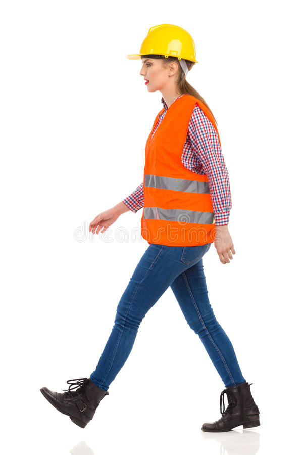 Focused Woman Construction Worker Walking stock photography