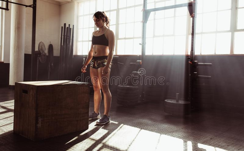 Focused young female athlete working out at gym stock image