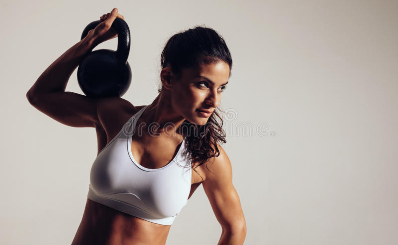 Focused young woman doing crossfit royalty free stock photo