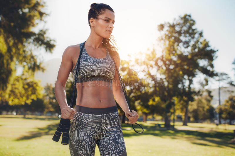 Focused young woman with jump rope at the park royalty free stock photos