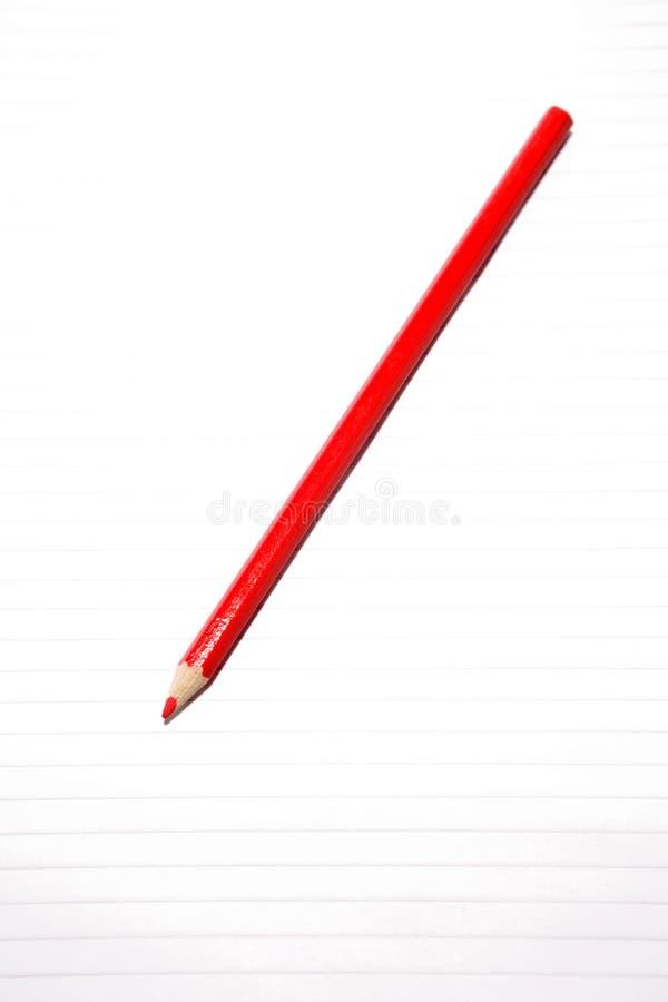 fodrad red för blyertspenna för anmärkningspapper fotografering för bildbyråer