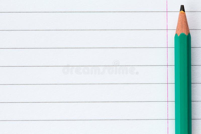 Fodrat papper för blyertspenna andl för skola arkivfoto