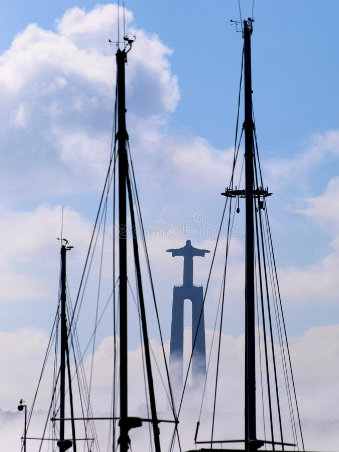 Christ Statue through the Masts. royalty free stock image