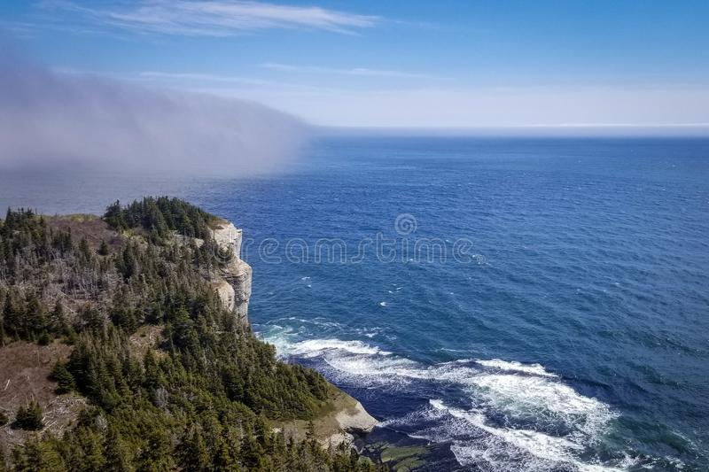 Fog bank rolling towards Cap Gaspé in Forillon National Park, Québec, Canada. Fog bank rolling towards Cap Gaspé headland in Forillon National Park, Qu stock photography