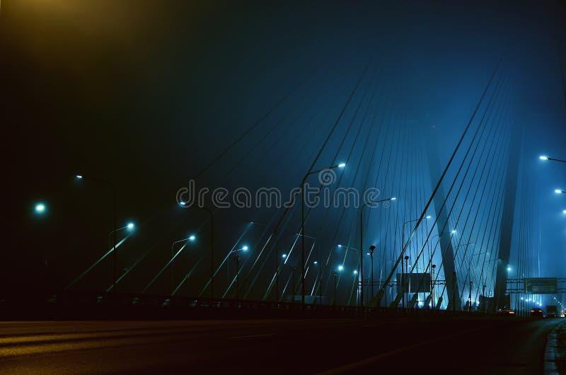 Fog on the bridge at night royalty free stock image