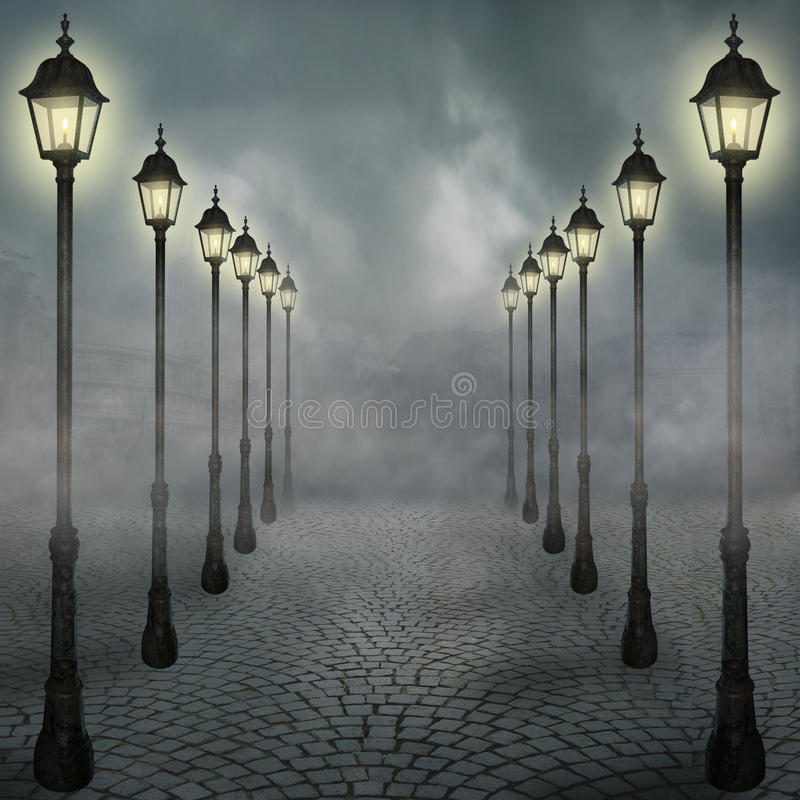 Fog in the city. View of a fog-covered street enlightened by lanterns and a city background
