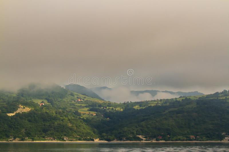 Foggy landscape of Iron Gate. Fog covered landscape cruising through the Iron Gate gorges on the Danube River between Serbia and Romania stock photos
