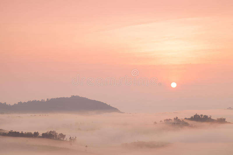 Fog covered mountains And the Rising Sun. Fog that covered the mountains and forests in the morning royalty free stock images