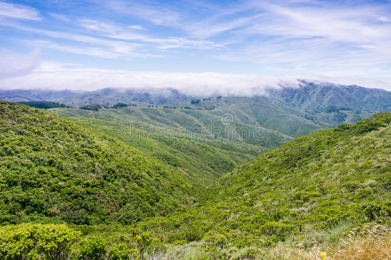 Fog covering the hills and valleys of Montara mountain McNee Ranch State Park landscape, California royalty free stock images