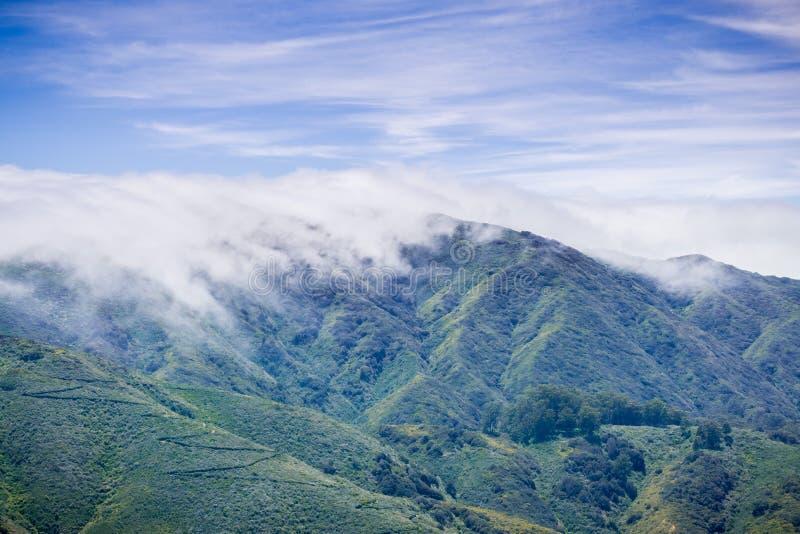 Fog covering Montara mountain McNee Ranch State Park landscape, California stock photos