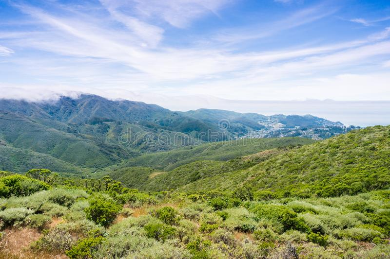 Fog covering the verdant hills and valleys of Montara mountain McNee Ranch State Park, California stock photos