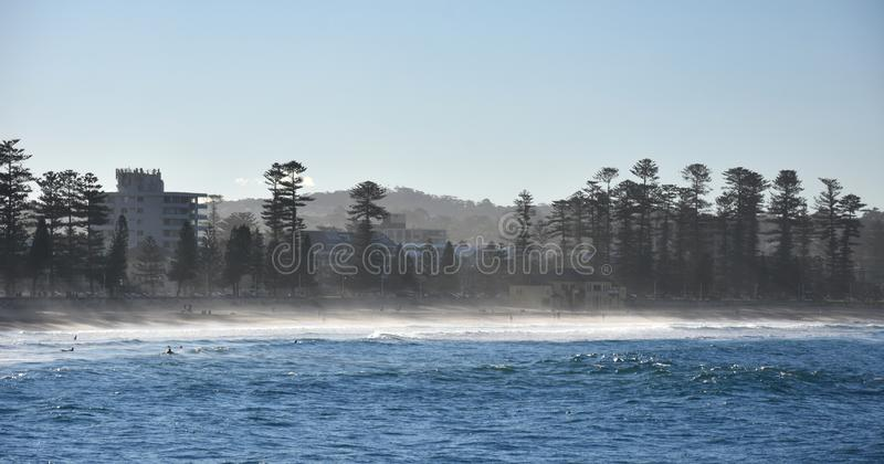 Fog Creeping in at Manly beach. Fog Creeping at Manly beach Sydney, Australia. People enjoy the sunbeams in winter stock photo