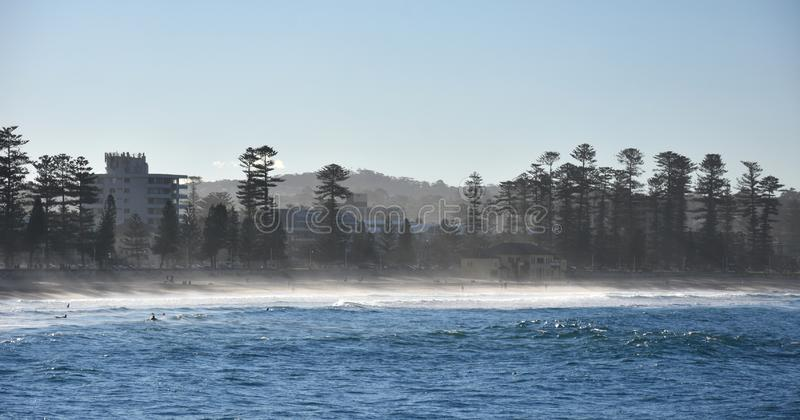 Fog Creeping in at Manly beach. Fog Creeping at Manly beach Sydney, Australia. People enjoy the sunbeams in winter stock photos