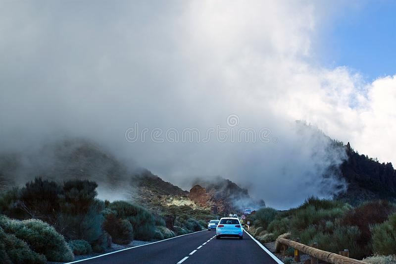 Fog descends towards the road between the gorges on the track to the Teide volcano, between the clouds movement, blurry, Tenerife stock images