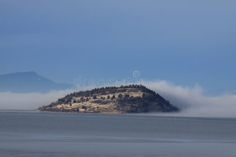 Fog Enveloping Buck Island on Upper Klamath Lake royalty free stock image