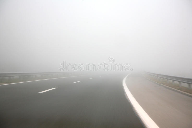 Fog on a highway stock images