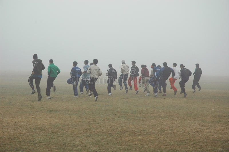 Fog in Kolkata. December 29,2010 Kolkata,West Bengal,India-People are doing exercise in the foggy morning at the kolkata playground royalty free stock photo