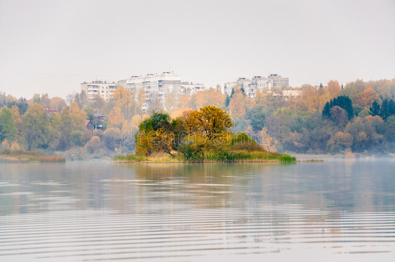 Fog on the lake Senezh in Solnechnogorsk fall in calm weather. The view of Raspberry island royalty free stock image