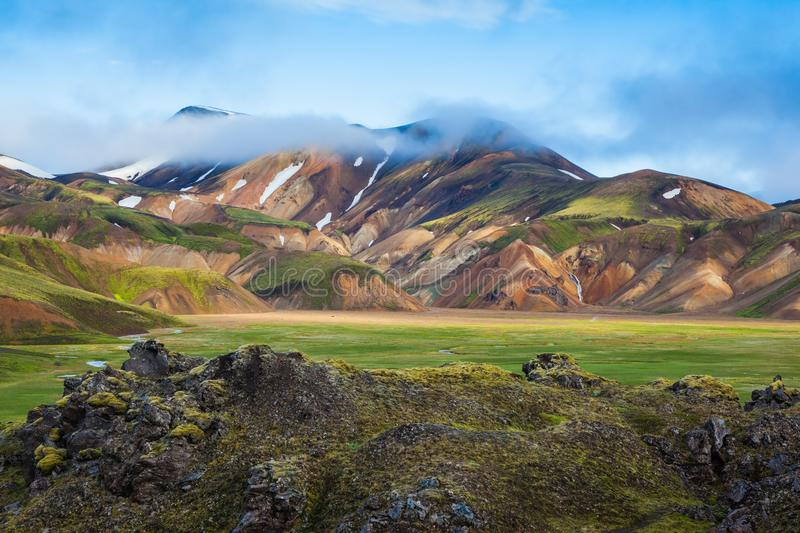 Fog lies in the hollows of colorful mountains royalty free stock photo