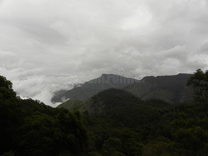 Fog, mist, dark clouds covered Palani hills of western ghats. Fog, mist, dark clouds covered Palani hills, western ghats covering an area of 2400 Sq. Km and the stock images