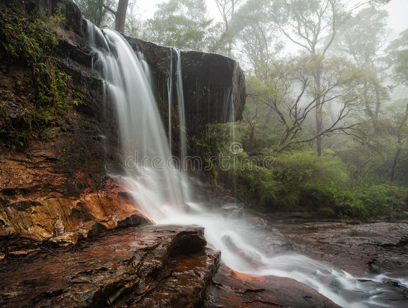 Fog and mist at Weeping Rock Wentworth Falls. Fog and mist at Weeping Rock in the upper section of Wentworth Falls during a chilly winter day royalty free stock image