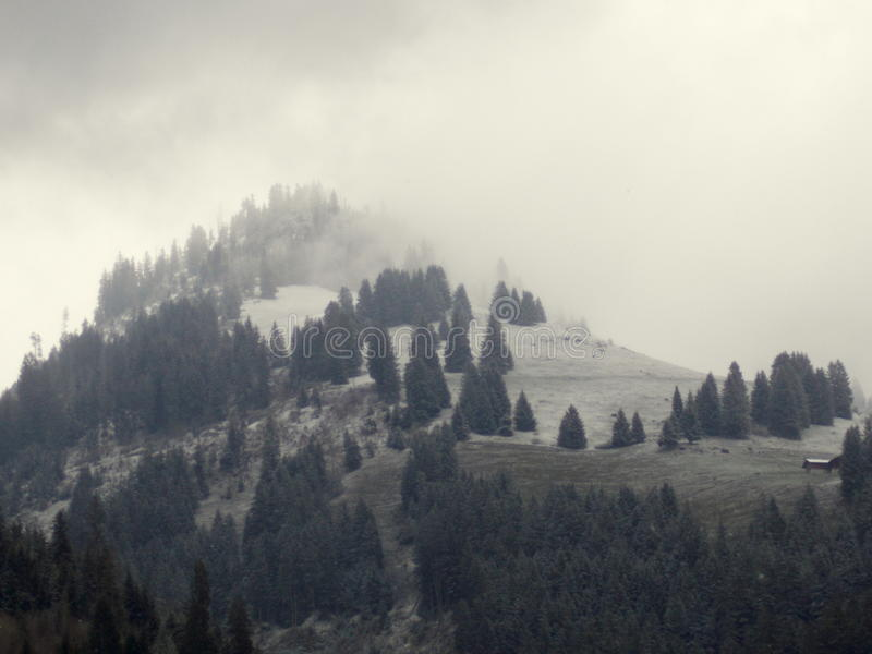Fog mountain. Mountain with fog and snow royalty free stock photography