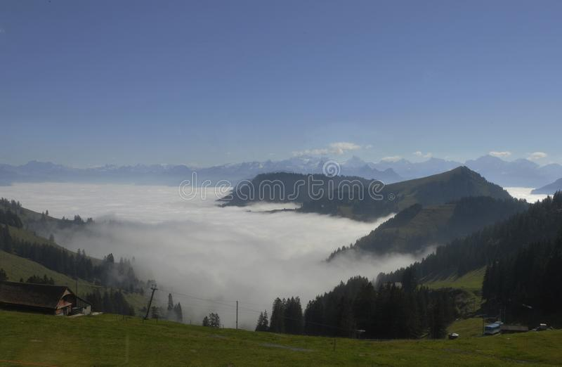 The fog-ocean over the swiss alps seen from Rigi-Kulm near Kaltbrunn in Central Switzerland royalty free stock photography