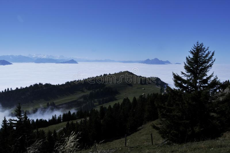 The fog-ocean over the swiss alps seen from Rigi-Kulm near Kaltbrunn in Central Switzerland royalty free stock photo