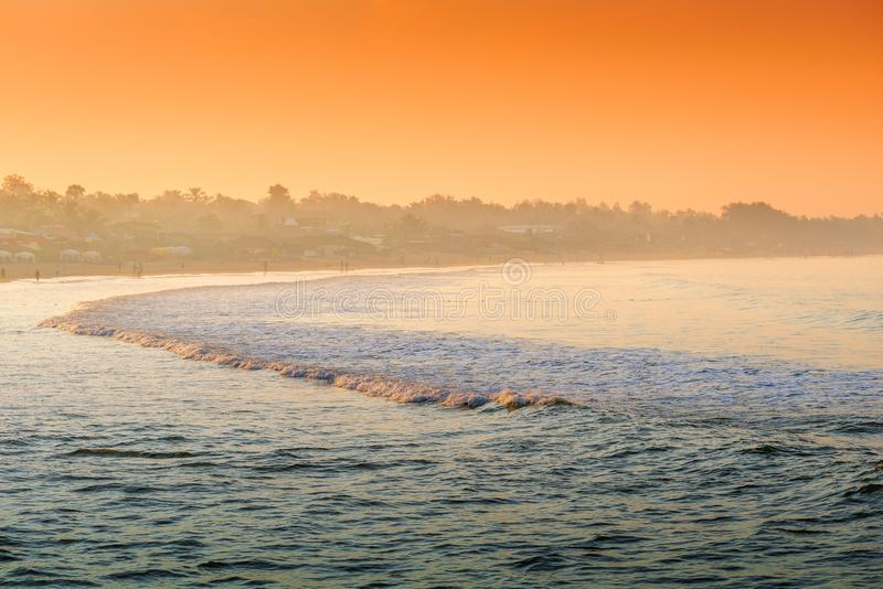 Fog oceanfront in the rays of the rising sun. Tinted stock photo