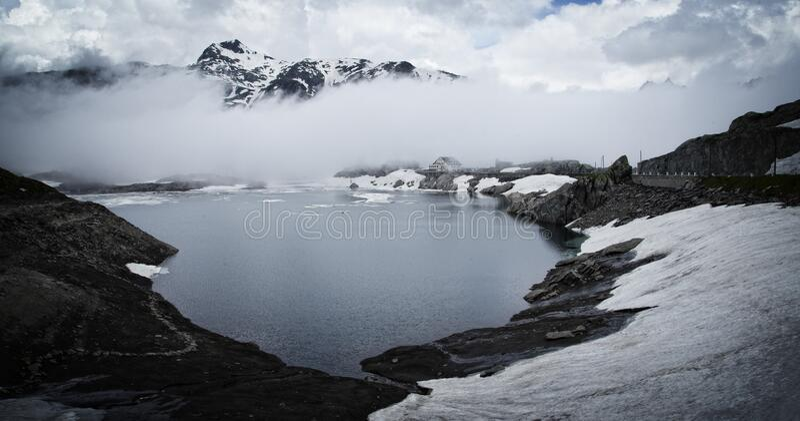 Fog over alpine lake stock photography