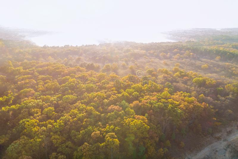 Fog over the autumn trees beautiful sunset panorama landscape. Sunset panorama fog over the autumn trees beautiful landscape, forest, morning, season, outdoor royalty free stock image