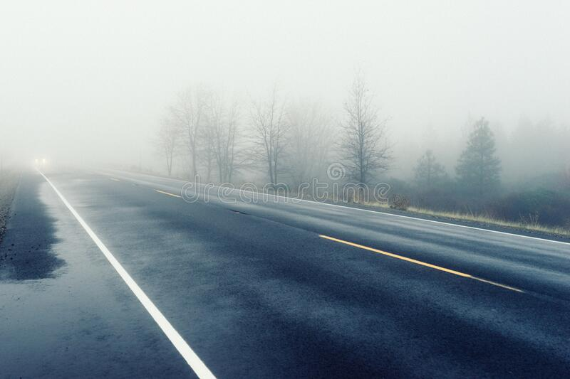 Fog over country road stock photos