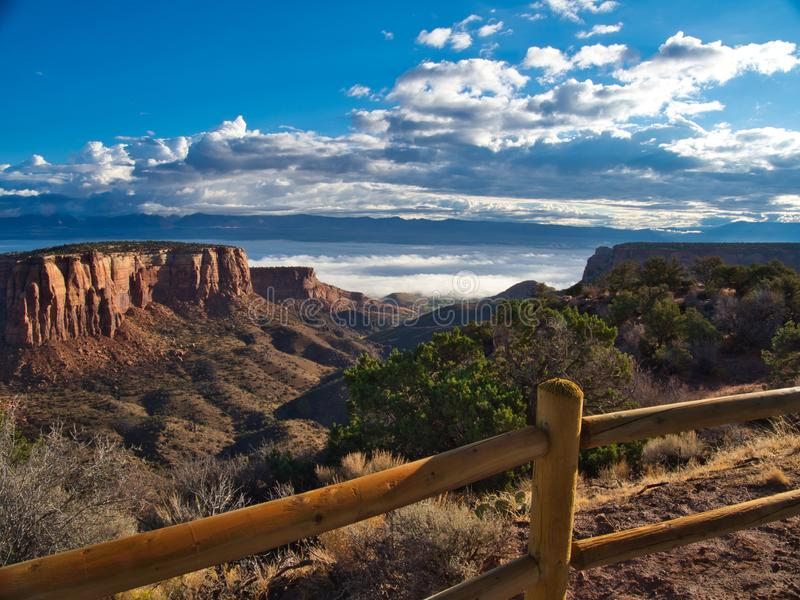 Fog Over Grand Junction. Above Grand Junction on a foggy morning. Colorado National Monument offers spectacular views of mountains and rock formations. Beautiful royalty free stock photography
