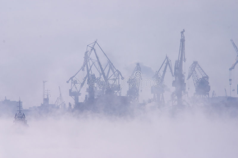 Fog over harbor stock photography