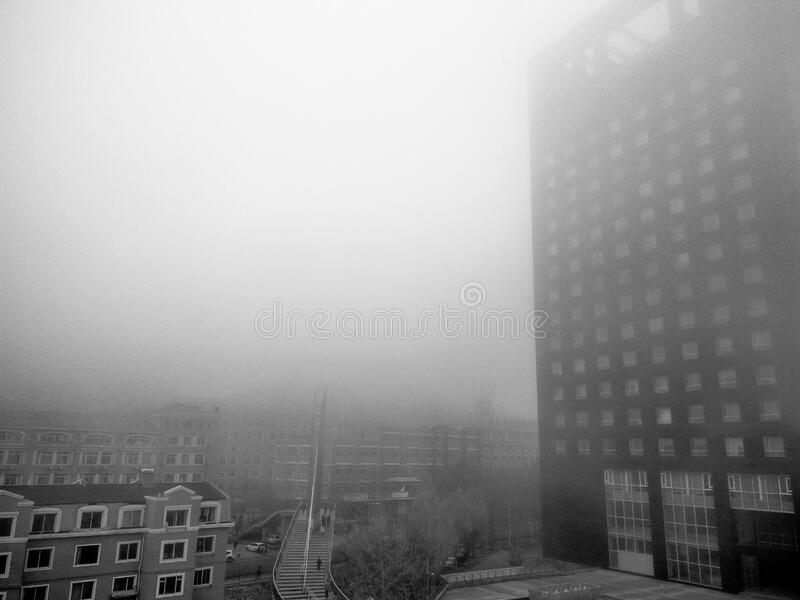 Fog over modern building stock photos