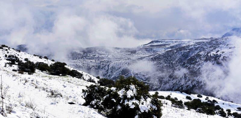 Fog over mountain peaks royalty free stock photos
