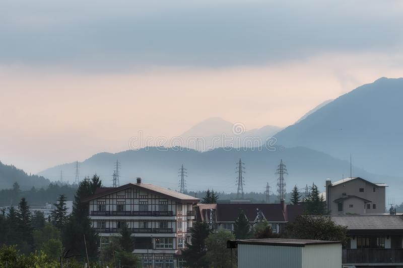 Foggy morning over the mountains and the village of Hakuba in Naga stock photo