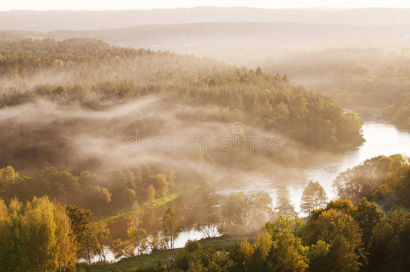 Fog over Neris river in Lithuania next to Vilnius City. Aerial view of fog over Neris river in Lithuania next to Vilnius City royalty free stock photography