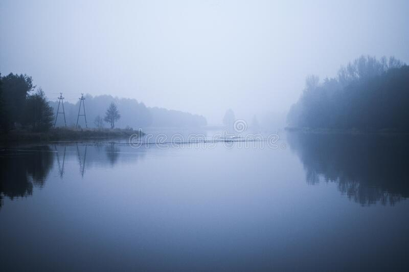 Fog over river banks royalty free stock images