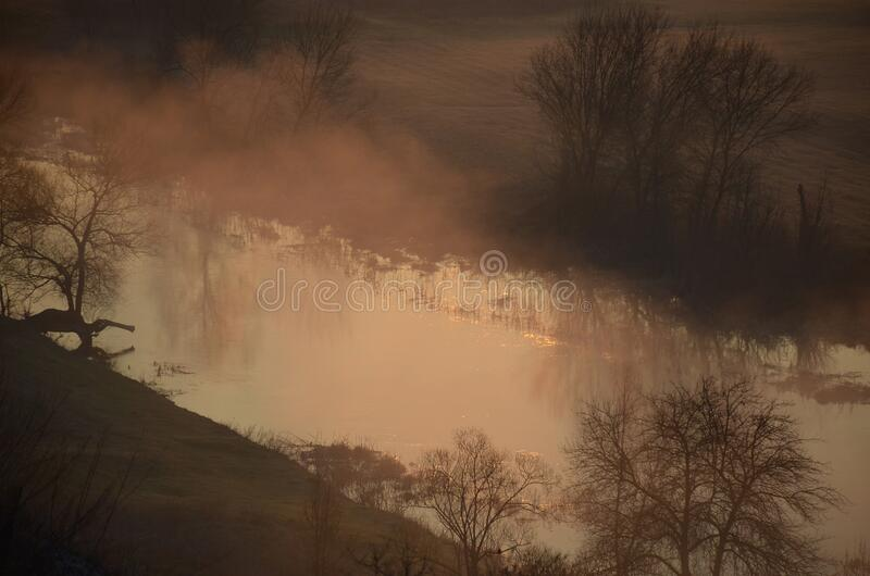 Fog over the river at dawn on a spring morning. Horizontal photo royalty free stock photo